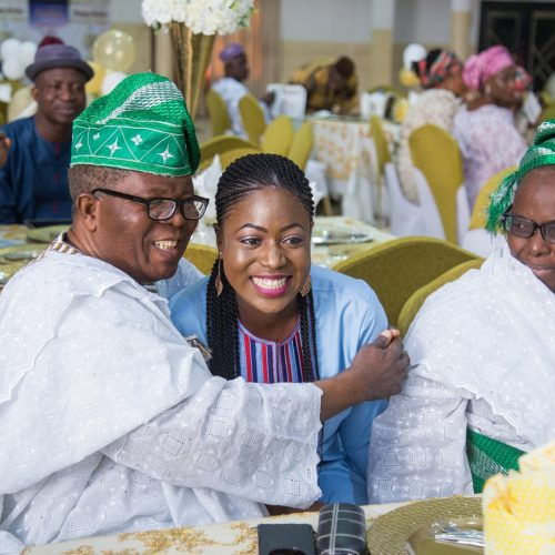Dr.  & Mrs Yomi Okunaiya sharing with celebrant's daughter