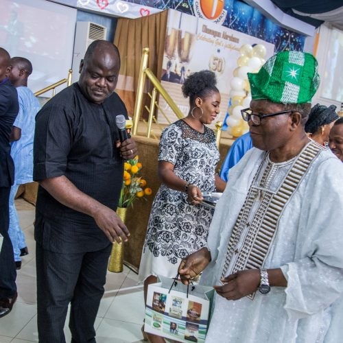 Celebrant's uncle, Dr.Yomi Okunaiya during the book launch