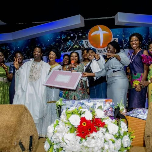 Celebrant receiving gifts from women group of Calvary Bible Church, Idimu, Lagos